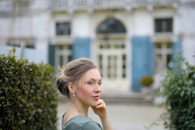 Woman outside Property